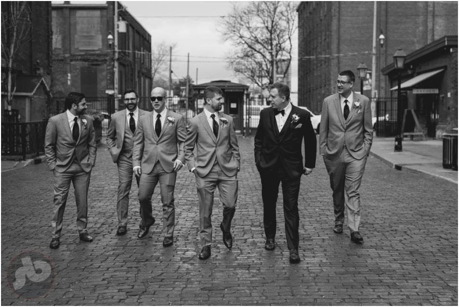 Kingston Wedding Photographer - Groom and Groomsmen walk into Distillery District