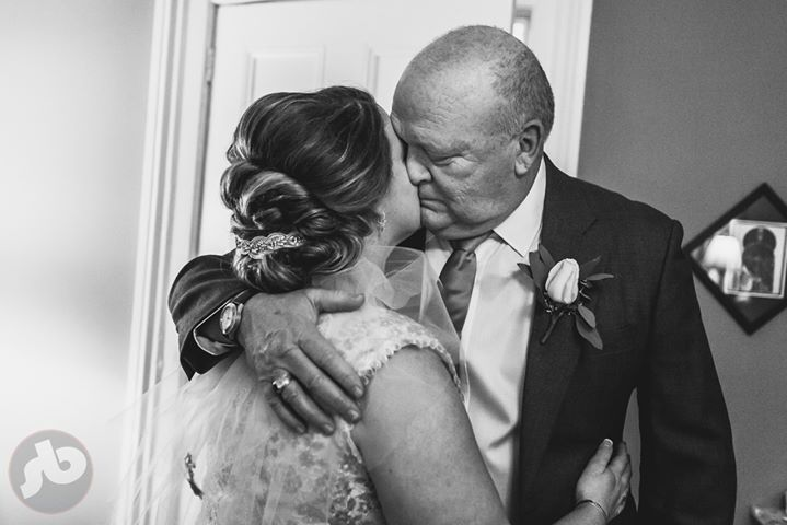 ...the moment he sees his daughter as she gets ready for him to walk her down th...