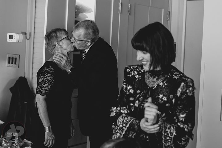 Michelle's dad steal a kiss from her mom as they gets ready to go downstairs at ...